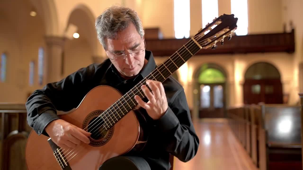 Charles Mokotof plays guitar in a church